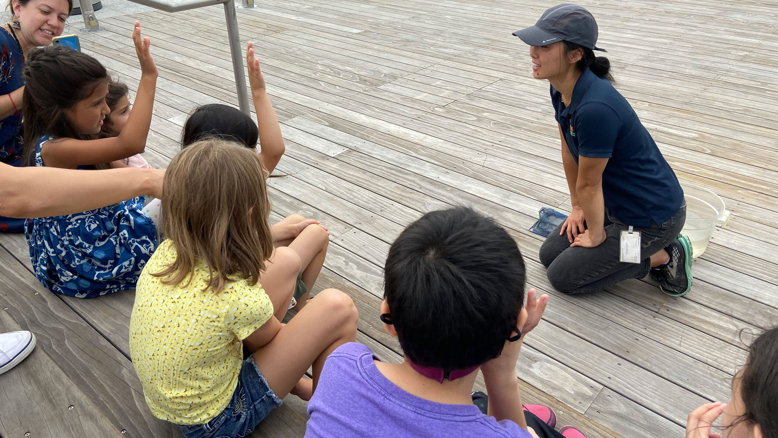HRPK River Project Park educators lead discussion with young students about the native wildlife and ecology of the Hudson River from the Pier 26 Tide Deck